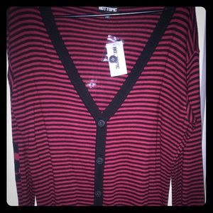 Red and black stripe sweater with skulls on elbows